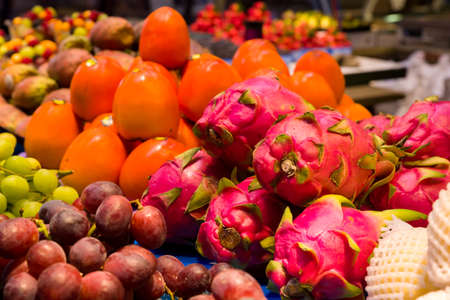 asian foods: Colorful display of dragon fruit and other vegetables and fruit in a Canadian grocery market Stock Photo