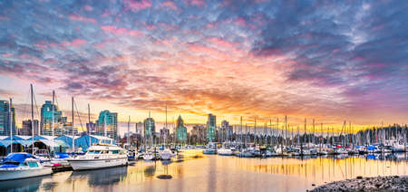 stunning: Stunning view of Coal Harbor in British Columbia featuring beautiful downtown buildings, boats,  and reflections on the water Stock Photo