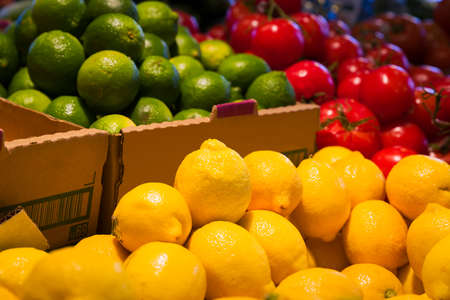 asian foods: Colorful display of yellow lemons and other vegetables and fruit in a Canadian grocery market Stock Photo
