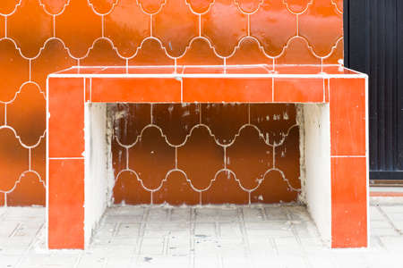 Distinctive orange tile bench and wall in Cozumel, Mexico Stock Photo