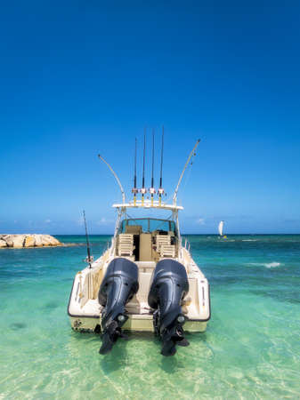 Fully equipped deep sea fishing boat in the beautiful ocean water of the Jamaican coast Reklamní fotografie
