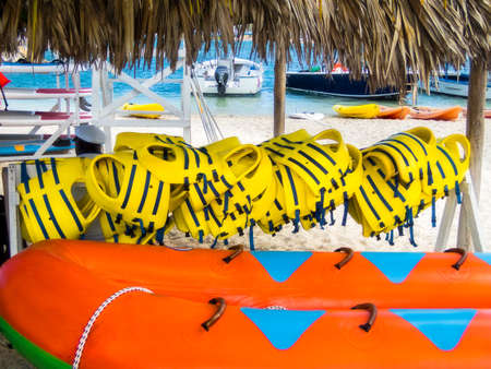 Colorful outdoor water sports equipment on display at a beachside rental venue in Jamaica