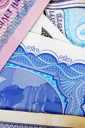 Colorful background of many banknotes from diverse countries
