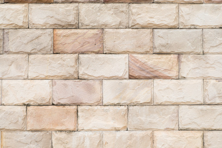 interiors design: Tiled brick wall in light sepia beige black white tone texture background for interiors design home, house, building, shop, store, art, coffee shop, popular brick wall. Brick. Vignette effect concept.