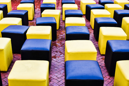 smooth legs: two colourful chairs in the garden Stock Photo