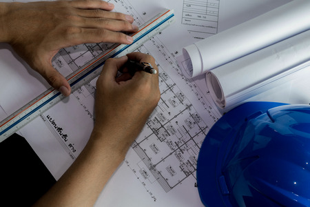 Workplace of architect - Architect rolls and plans.architectural plan,technical project drawing. Engineering tools view from the top. Construction background Imagens