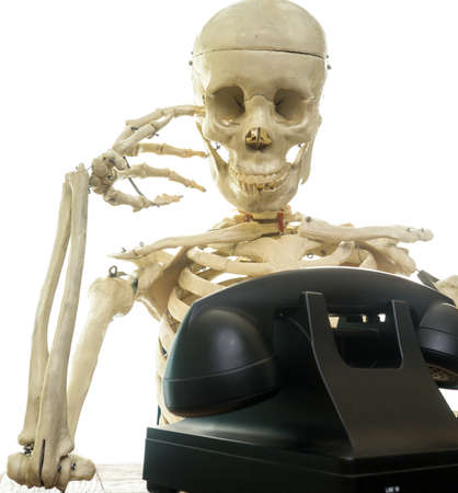 phone: Skeleton waiting for the phone to ring Stock Photo
