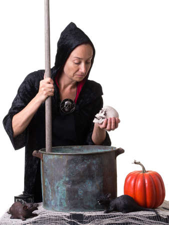 Witch stirring up a spell Stock fotó