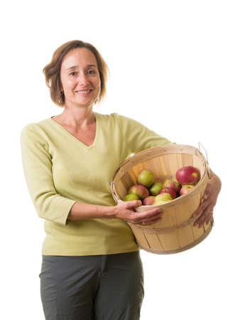 Women with wooden bucket full of apples