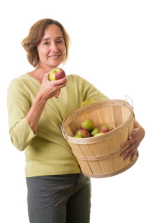 Women with wooden bucket full of apples photo
