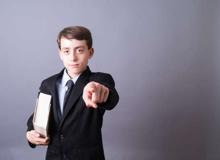 Young Attorney or businessman with large book pointing Stock fotó