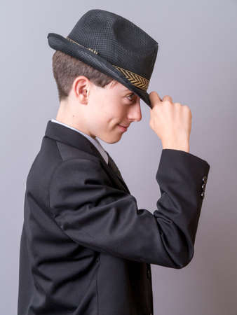 Teen boy tipping his hat photo