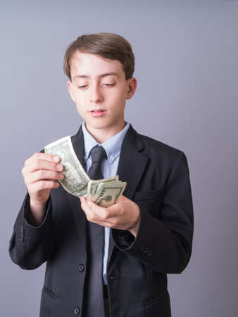 Young businessman or attorney counting his money Stock fotó