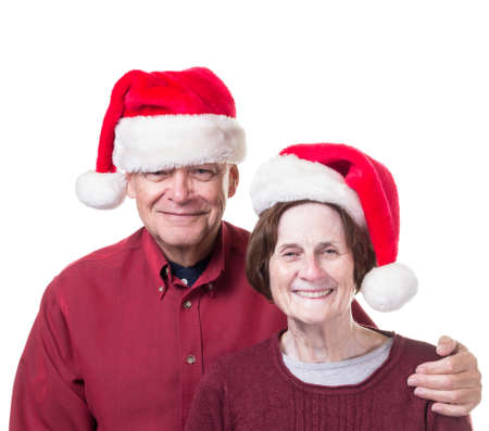 Senior Christmas couple in Santa hats