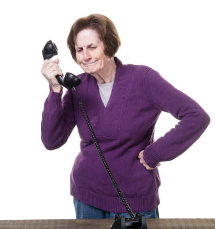 Angry senior women on the telephone Stock Photo - 15561871