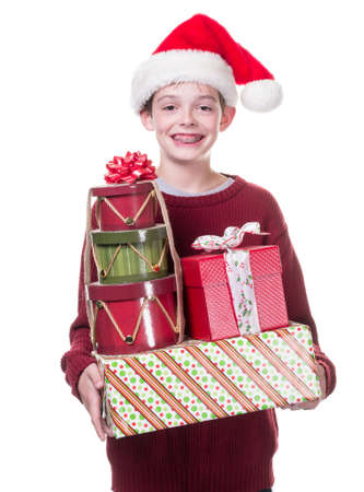 Boy with arm load of Christmas gifts