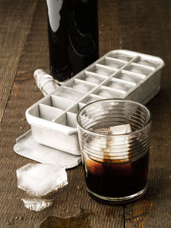 On the rocks, A glass of alcohol and a vintage ice cube tray
