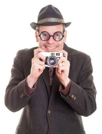 Funny happy smiling man with camera