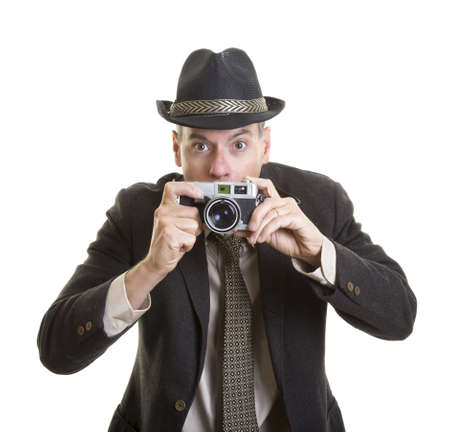 Man taking photograph with vintage film camera