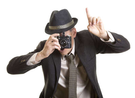 Man taking photograph with vintage camera Imagens