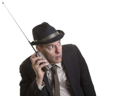 Man listening intently to portable radio