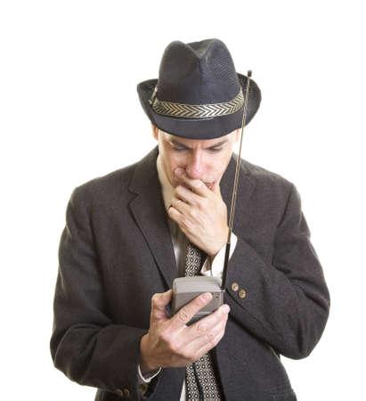 Man watching portable TV Stock fotó