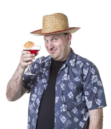 Tourist man enjoying his vacation with a tropical drink