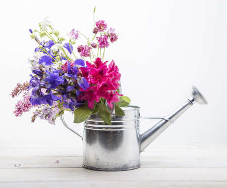 Fresh picked flowers in a watering can