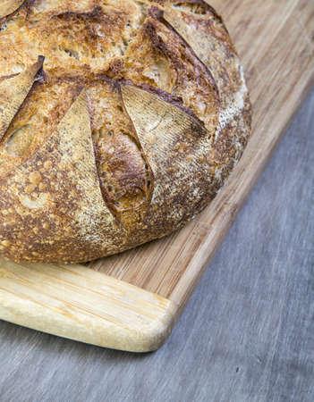 Fresh baked crusty artisan bread on cutting board
