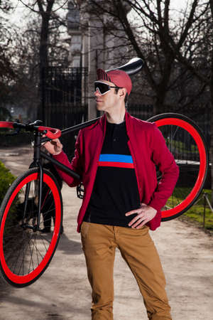 cyclist posing with his bike in the park 03