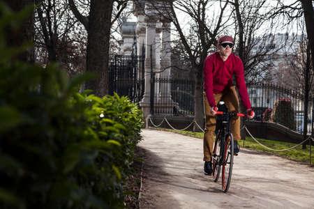 cyclist ride on the park near the street