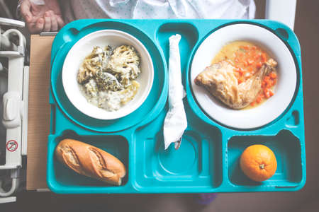 tray with hospital food near the window Imagens