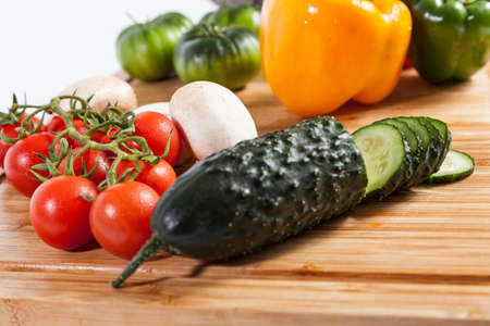 composition of vegetables with tomatoes and peppers on bamboo wooden board