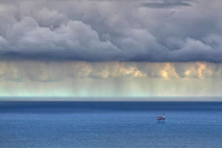 Storm over the North Sea in Spain with oil rig in the background