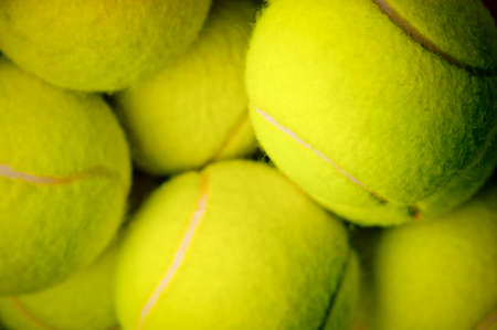 pile of yellow tennis balls