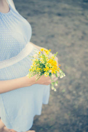 Wildflowers pregnant maternity birth child expectation Stock Photo