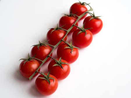 tomatoes on a white background Stock Photo