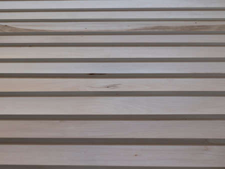 The wooden slats on the background of blurred white walls. Texture Foto de archivo
