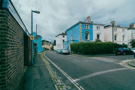 live work city: suburban street with cloudy sky Stock Photo