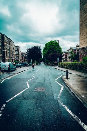 live work city: suburban street in cloudy weather