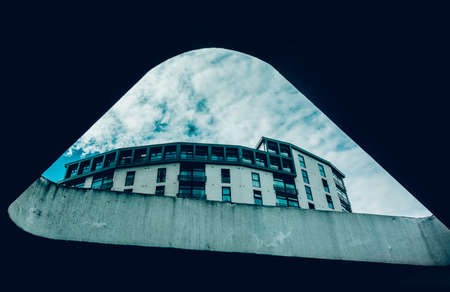 periphery: Bottom view of a black and white building. Photographed in Bristol