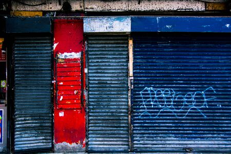 red shutters: shutters of shops painted in blue and red
