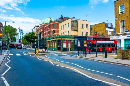 periphery: London street with passage of the typical red double-decker bus