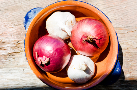 Cooking ingredients: onions and garlic in a bowl