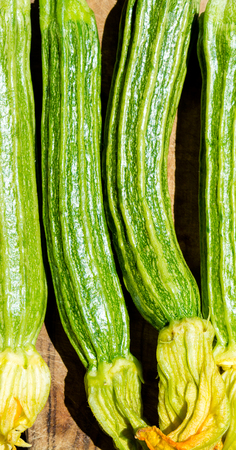 Zucchini on a cutting board with top view Stock Photo