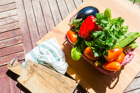 Fruit, vegetables and herbs on a wooden board