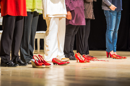 Red shoes on a stage, the symbol of violence against women