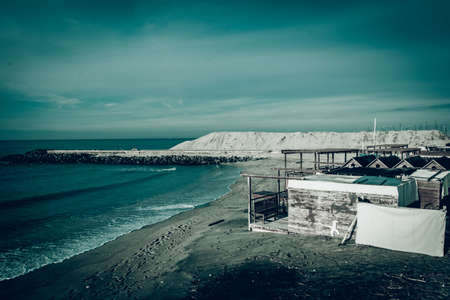 The sea and the abandoned beach: image with cool and dramatic tones