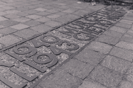 Commemorative plaque in the Jewish ghetto of Warsaw, in black and white