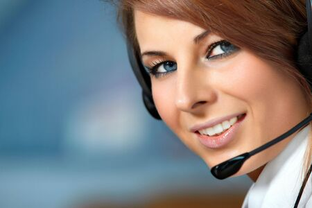 personal call: Beautiful representative smiling call center woman with headset. Stock Photo